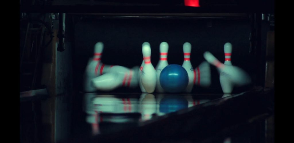 Photo of pins splashing bowling lingo