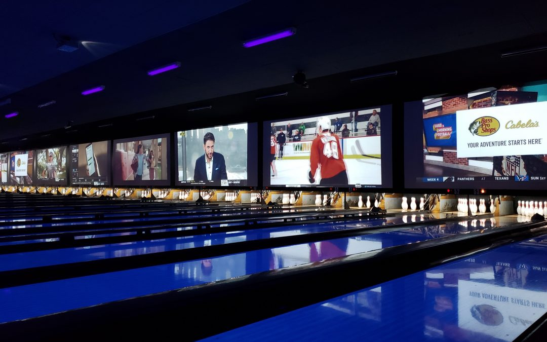 photo of screens over bowling lanes